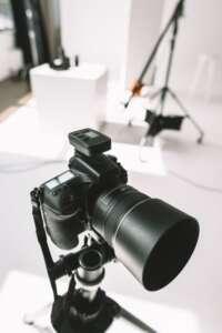 Photo studio with digital photo camera and lighting equipment